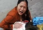 Weeping mother holds her unconscious son in the street after a valve plummeted 21 storeys on to his head