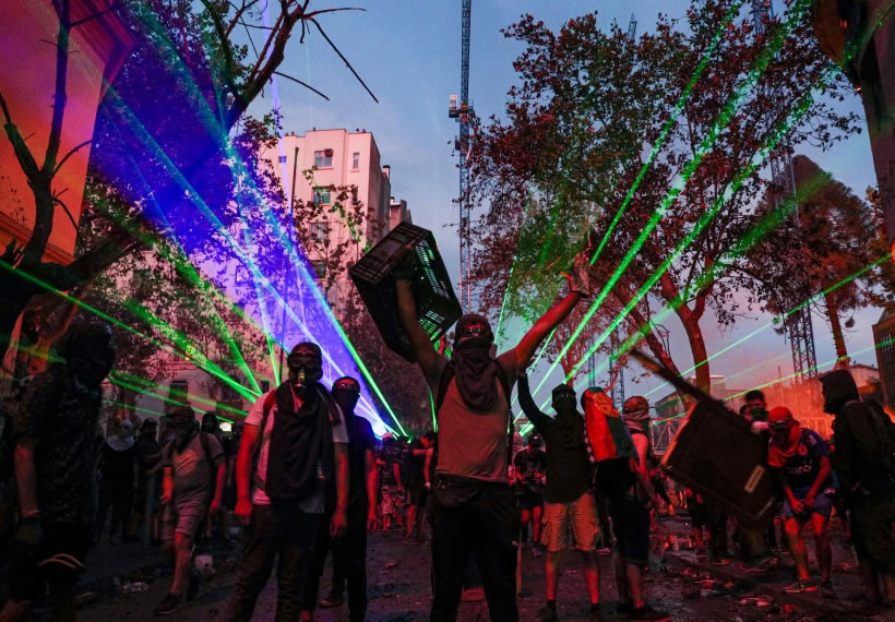 Protesters in Chile use lasers to bring down police drone