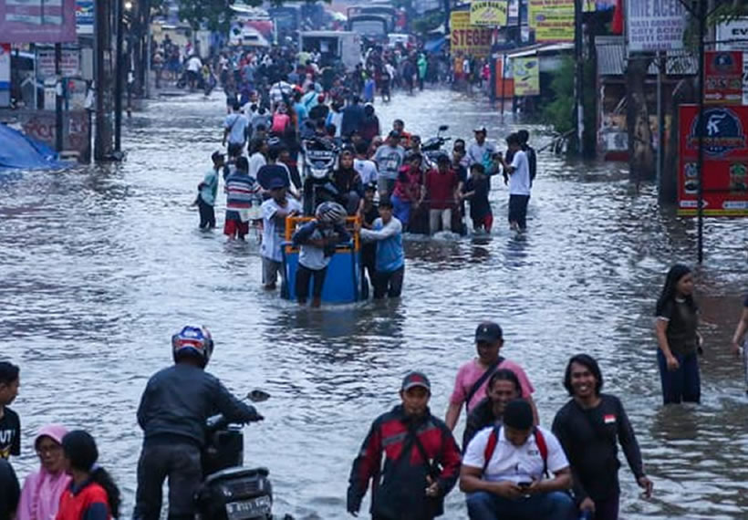 Floods in Indonesia capital paralyse parts of city, cut power