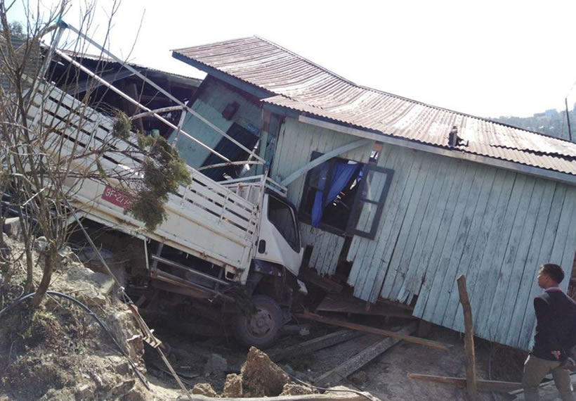 Canter truck crushed to home
