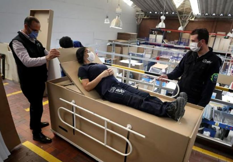 Cardboard hospital beds that double as coffins made in Colombia