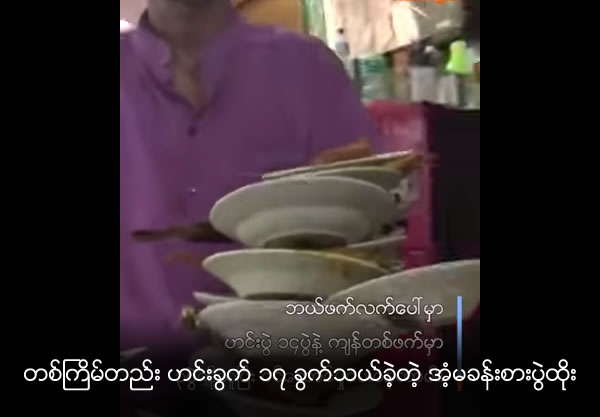 Talented waiter carries 17 food-filled plates at once