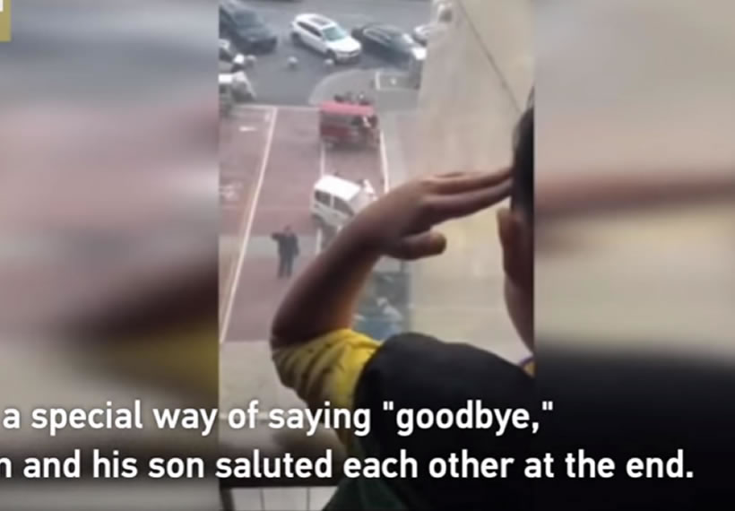 Father and son salute each other through window amid coronavirus outbreak