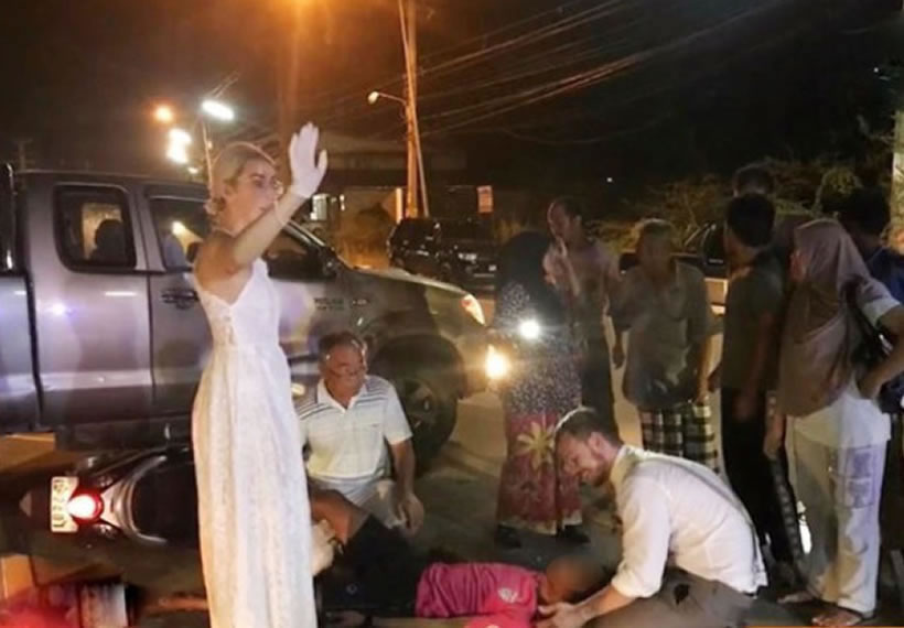 Couple heading to wedding in Krabi make pit stop to help injured motorcyclist