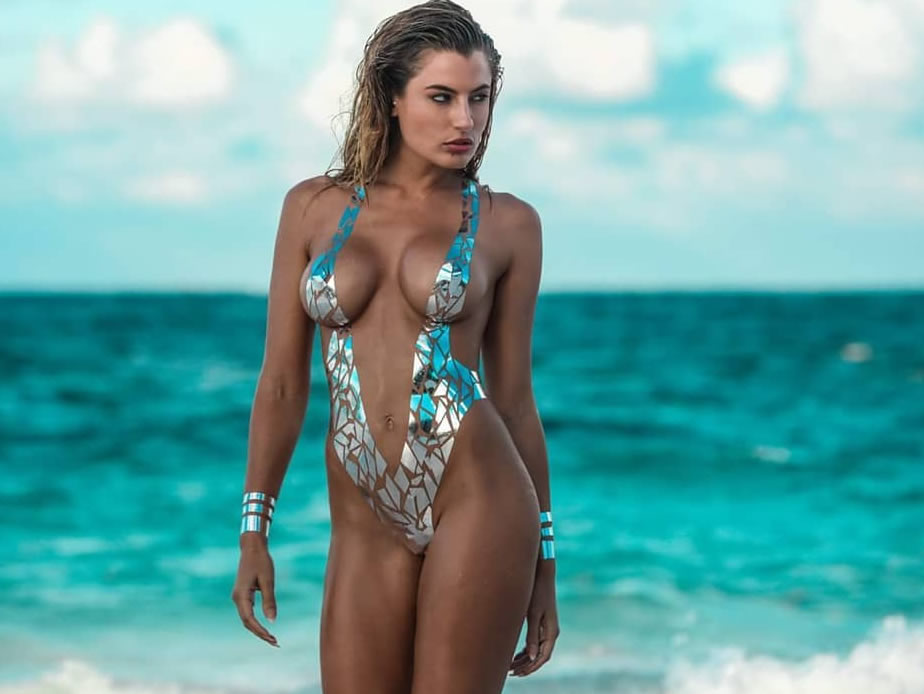 Stick on swimwear is summer's hottest new trend as models storm Miami catwalk in Duct-tape bikinis